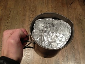 Insert small aluminum baking loaf re-shpaed to fir the pot.