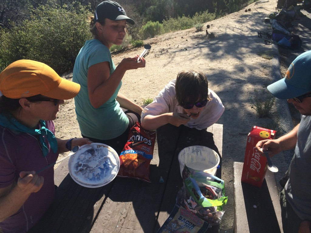 Tour Guide, Promise, Sadie, and Scott eating magical nom snacks.